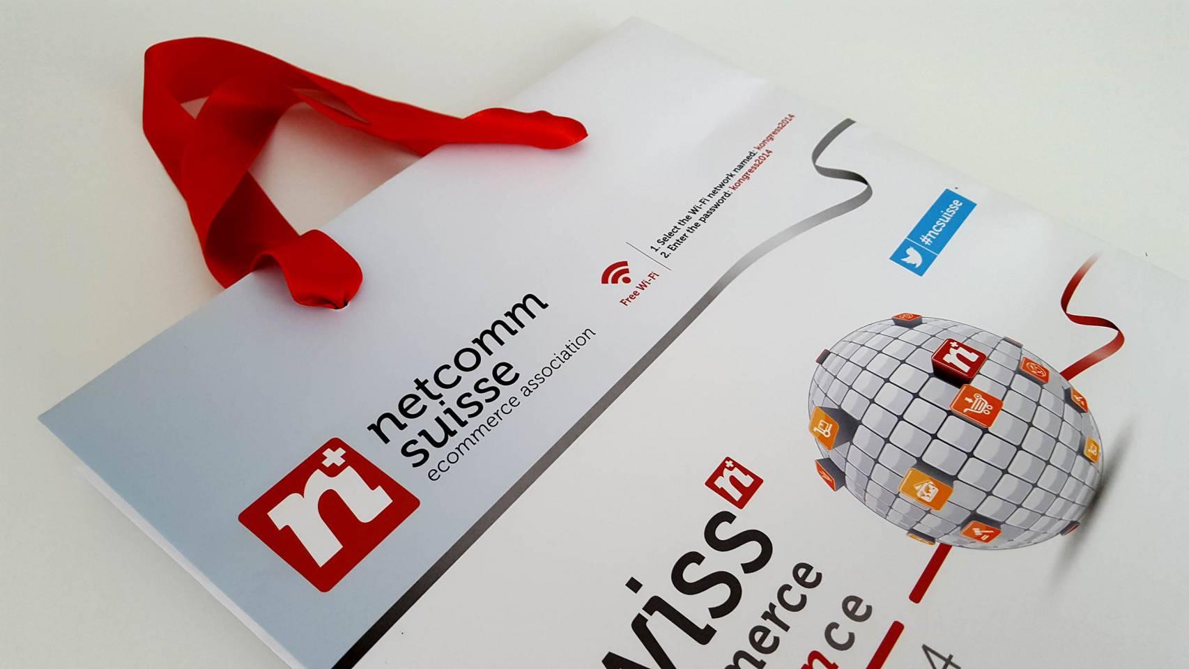 Produzione oggetti promozionali NetComm Suisse ecommerce NewVisibility web agency Como